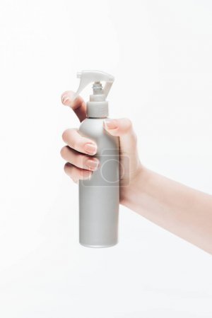 cropped shot of woman holding blank cosmetic spray bottle isolated on white