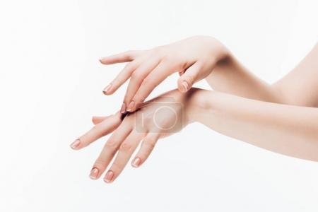 Photo pour Plan recadré de la femme appliquant crème hydratante sur les mains isolées sur blanc - image libre de droit