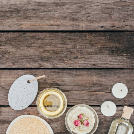 Photo for Top view of oil, salt, pumice and spa treatment on wooden table - Royalty Free Image