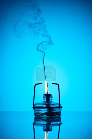 chemical heater with fire and smoke on blue