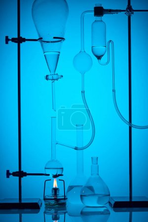 chemical analysis with substance in laboratory on blue