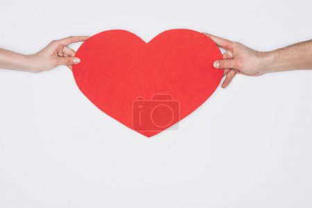 cropped shot of woman and man holding red heart isolated on white, st valentines day concept