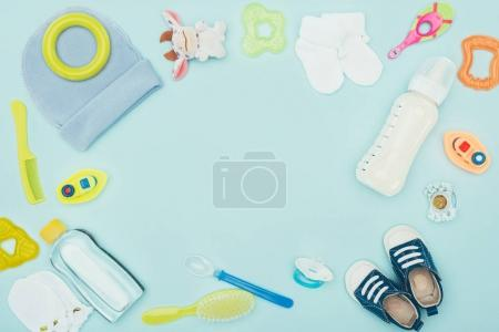 Photo for Top view of baby clothes, equipment and milk isolated on blue - Royalty Free Image
