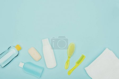 top view of bathroom accessories scattered isolated on blue