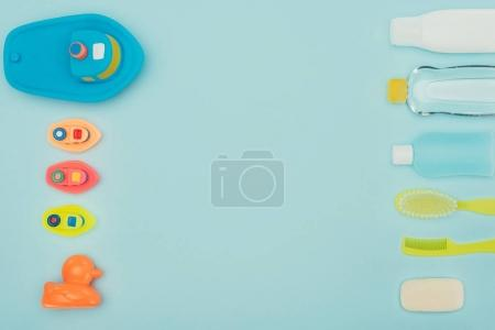 top view of baby toys and bathroom accessories isolated on blue