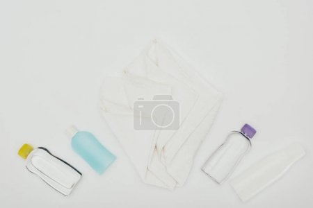 top view of bathroom accessories and towel isolated on white