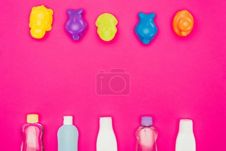 Photo for Top view of baby toys and bathroom accessories isolated on pink - Royalty Free Image