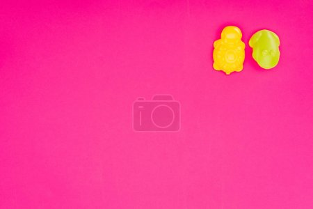 top view of baby toys isolated on pink