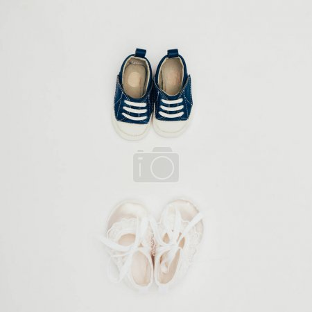 top view of two pairs of baby shoes isolated on white