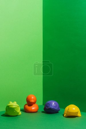 colored baby toys in shape of animals on green