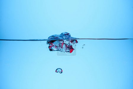 Photo for Bubbles in clear water, isolated on blue - Royalty Free Image