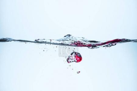 ice cubes in flowing water with bubbles, isolated on white