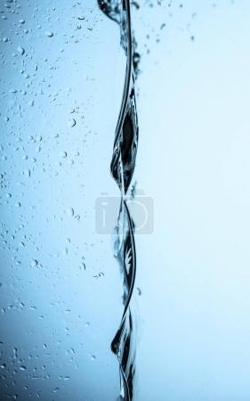 flowing water texture with drops, isolated on white