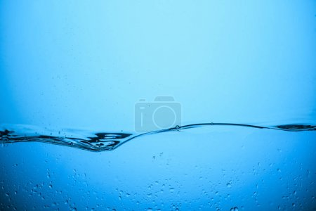 Photo for Flowing water background with drops, isolated on blue - Royalty Free Image
