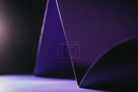 close up view of purple paper on black