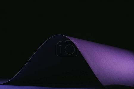 warping simple purple paper on black