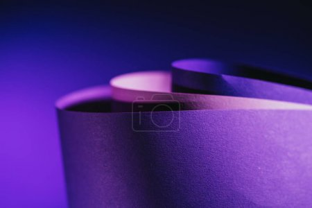 close up view of arcs of purple and pink paper on purple