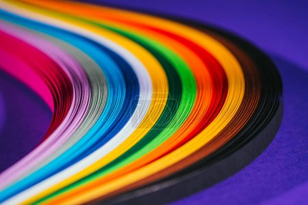 colored bright quilling paper stripes on purple