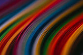 close up of colored quilling paper curves