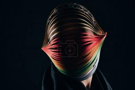 woman with colored quilling paper on head isolated on black