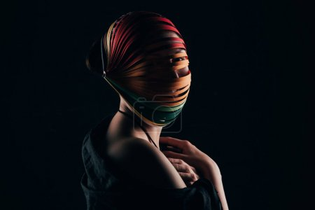 woman with colored quilling paper on head and naked shoulder isolated on black