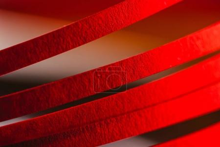 close up view of red quilling striped paper