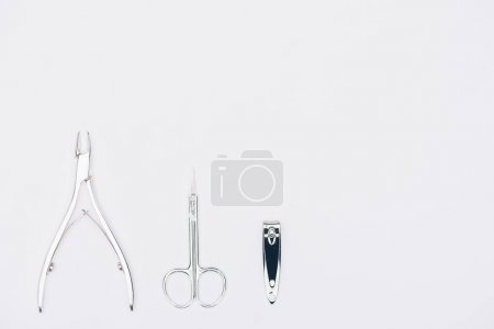 Photo for Top view of nail nippers and scissors isolated on white - Royalty Free Image