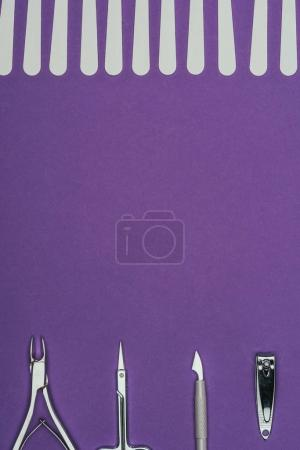 top view of manicure tools isolated on purple