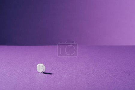 close up view of medicine on purple background
