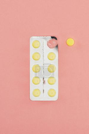 Photo for Top view of pills isolated on pink backdrop - Royalty Free Image