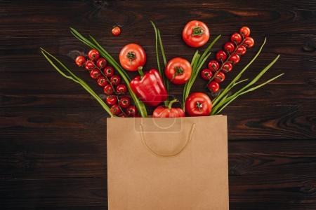 Photo for Top view of different red vegetables in shopping bag, grocery concept - Royalty Free Image