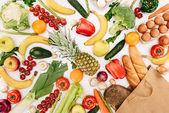 """Постер, картина, фотообои """"вид сверху овощей и фруктов и хлеба в корзине, изолированные на белом, продуктовые концепции"""""""