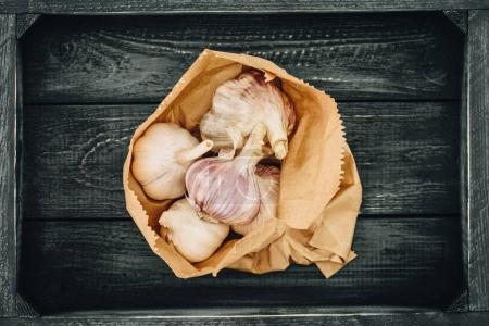 Photo for Top view of garlic in shopping paper bag - Royalty Free Image