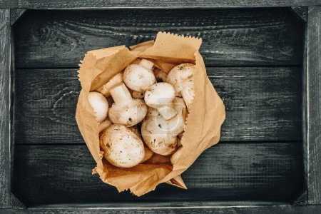 top view of mushrooms in shopping paper bag