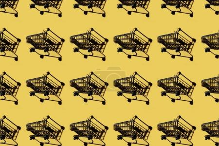 set of shopping carts with shadows on yellow