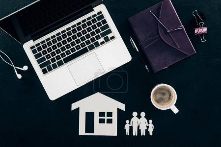 top view of business workplace with home and family insurance concept isolated on black