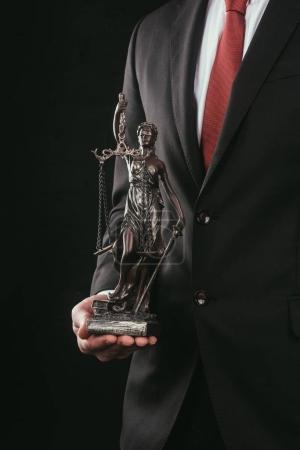 cropped shot of lawyer holding themis sculpture isolated on black