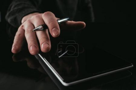 cropped shot of businessman using digital tablet