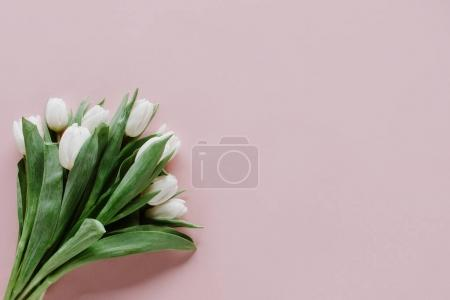 top view of bouquet of white tulip flowers on pink
