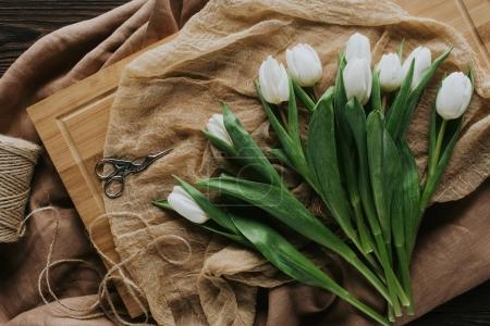 Photo for Top view of white spring tulips on wooden board for international womens day - Royalty Free Image