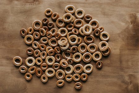 top view of sweet tasty bagels on wooden table