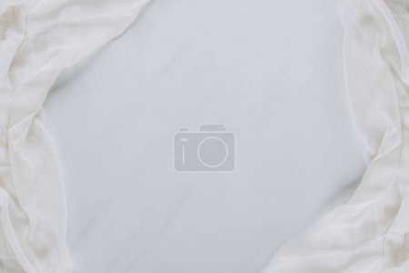 Photo for Top view of white fabric and blank grey background - Royalty Free Image