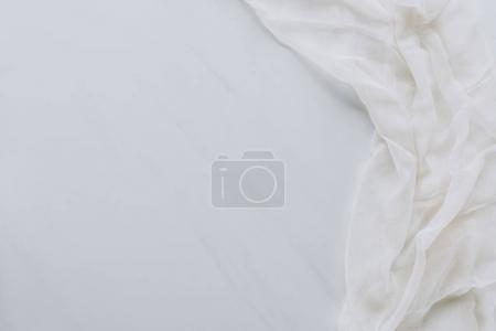 Foto de Vista superior de la tela blanca y blanco fondo gris - Imagen libre de derechos