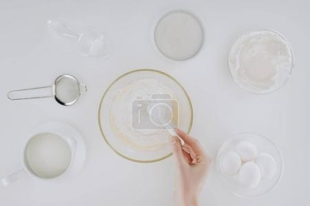 Photo for Cropped shot of person preparing dough while cooking pancakes isolated on grey - Royalty Free Image