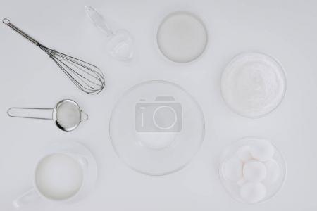 top view of utensils and ingredients for cooking pancakes isolated on grey