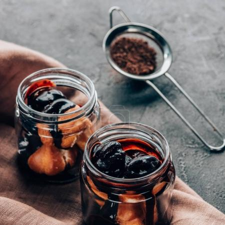 Photo for Close-up view of sweet tasty homemade chocolate dessert in glass jars - Royalty Free Image