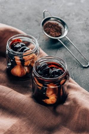 close-up view of sweet homemade chocolate dessert in glass jars