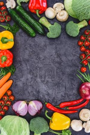Photo for Top view of fresh raw healthy organic vegetables on black - Royalty Free Image