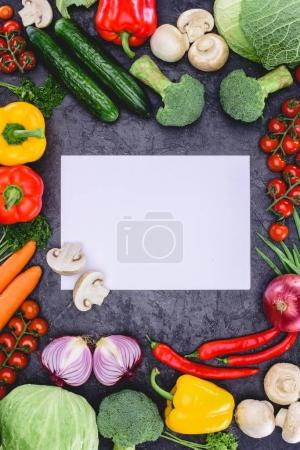 top view of fresh raw vegetables and blank paper