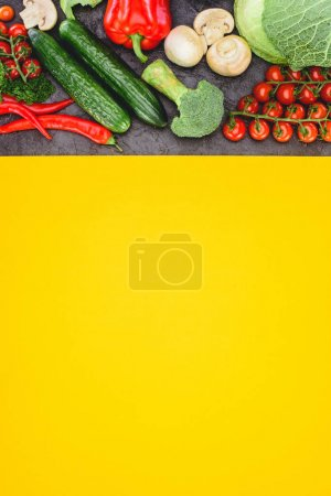 Photo for Top view of fresh healthy assorted vegetables with yellow background - Royalty Free Image